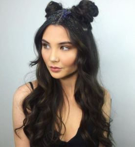 Update your look with a half-up double topknot hairstyle