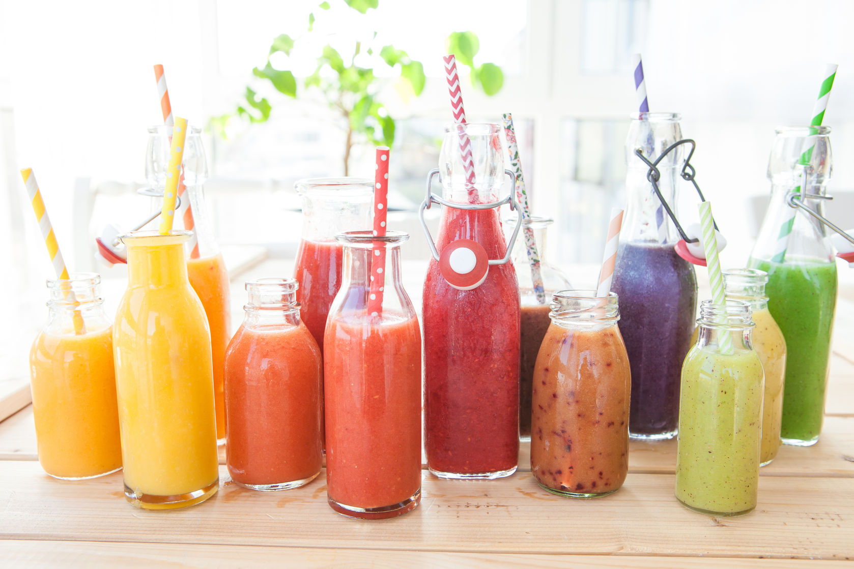 53898163 - variety of fresh smoothies in rainbow colors